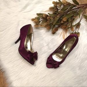 Pretty plum bow heels